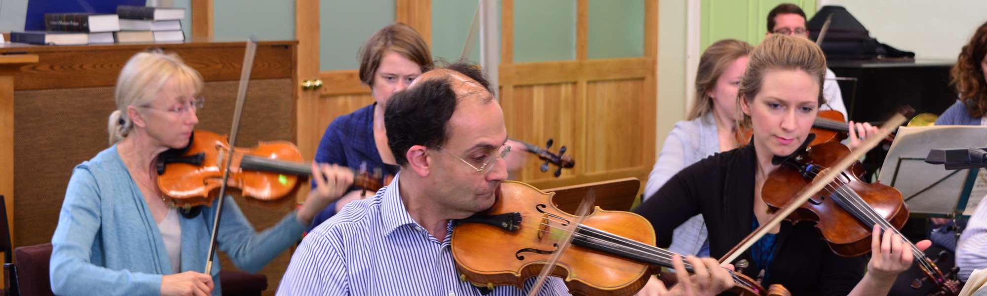 FSO first violins in rehearsal
